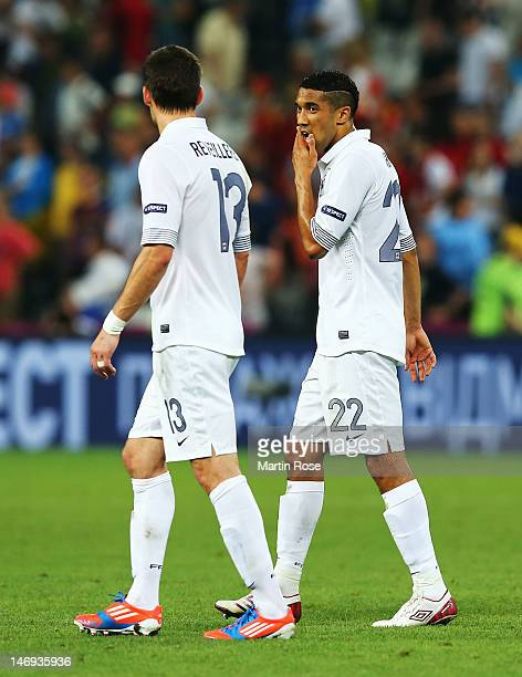 Anthony Reveillere and Gael Clichy of France look dejected after defeat during the UEFA EURO 2012 quarter final match between Spain and France at...