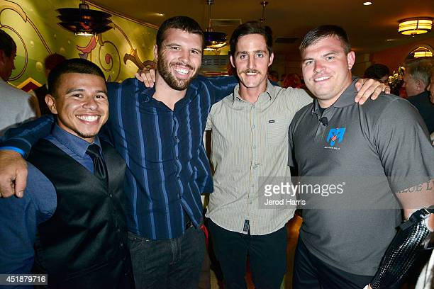 Anthony Reynoso, Chris Eidson, Ryan Murphy and Travis Mills attend Gary Sinise Foundation's 'Travis: A Soldier's Story' benefit screening at Village...