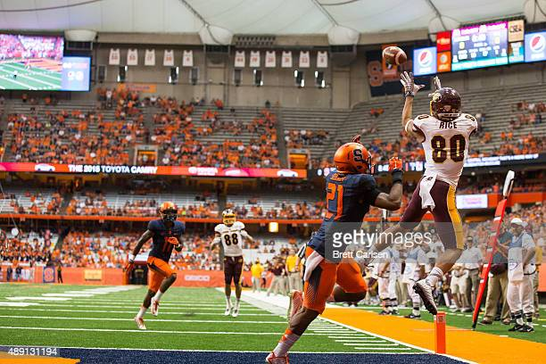 Anthony Rice of the Central Michigan Chippewas jumps and fails to bring in a touchdown pass attempt as Chauncey Scissum of the Syracuse Orange...