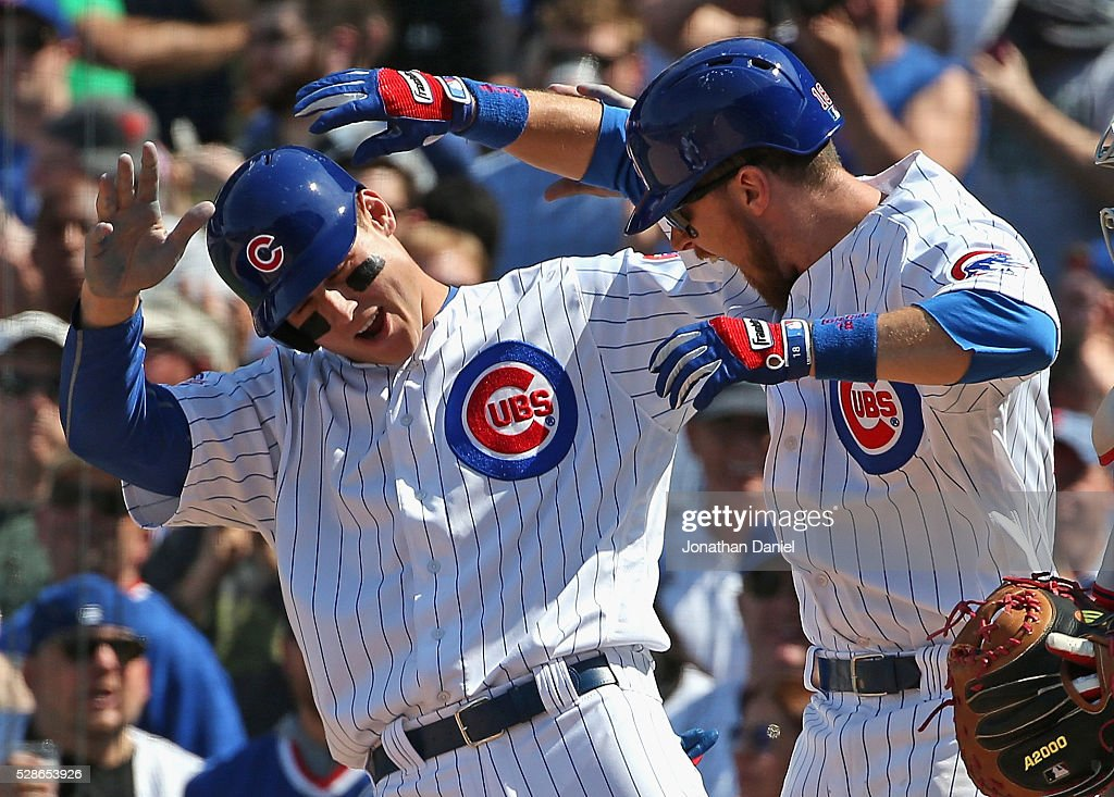 Anthony Rizzo #44 (L) and Ben Zobrist #18 of the Chicago Cubs celebrate Zobrist's three run home run in the 5th inning against the Washington Nationals at Wrigley Field on May 6, 2016 in Chicago, Illinois.