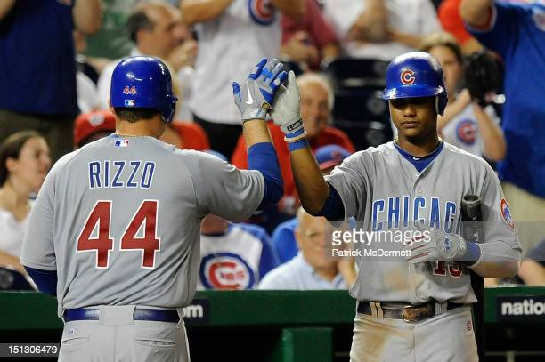Anthony Rizzo celebrates with Starlin Castro of the Chicago Cubs after hitting a home run in the ninth inning against the Washington Nationals at...