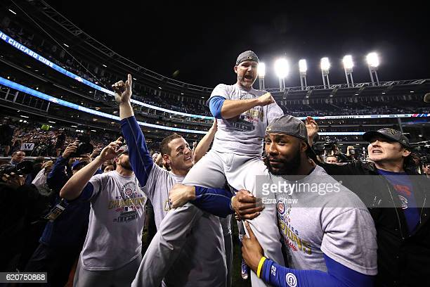 Anthony Rizzo David Ross and Jason Heyward of the Chicago Cubs celebrate with actor John Cusack after defeating the Cleveland Indians 87 in Game...