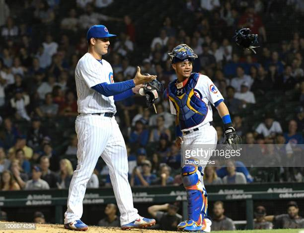 Anthony Rizzo first baseman of the Chicago Cubs comes in to pitch against the Arizona Diamondbacks during the ninth inning on July 23 2018 at Wrigley...