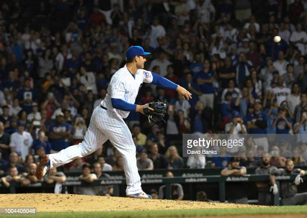 Anthony Rizzo first baseman of the Chicago Cubs pitches against the Arizona Diamondbacks during the ninth inning on July 23 2018 at Wrigley Field in...
