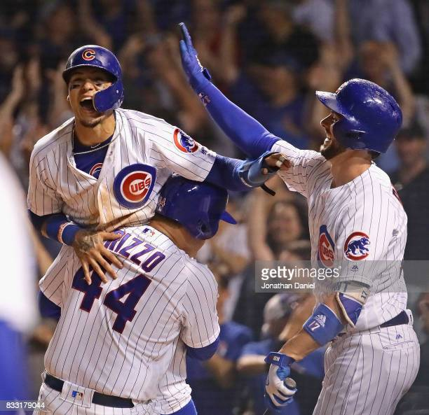 Anthony Rizzo Javier Baez and Kris Bryant celebrate after Baez scored the winning run on a wild pitch in the bottom of the 9th inning against the...