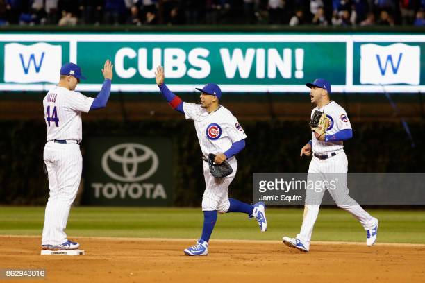 Anthony Rizzo Jon Jay and Albert Almora Jr #5 of the Chicago Cubs celebrate defeating the Los Angeles Dodgers 32 in game four of the National League...