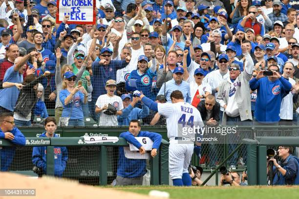 Anthony Rizzo of the Chicago Cubs acknowledges the crowd after hitting a solo home run during the fifth inning against the Milwaukee Brewers on...