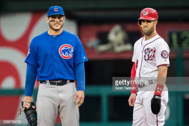 Anthony Rizzo of the Chicago Cubs and Bryce Harper of the Washington Nationals look on during the first inning of game one of a doubleheader at...
