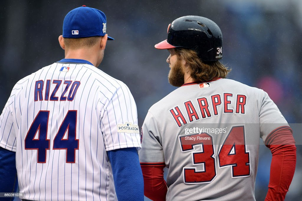 Anthony Rizzo #44 of the Chicago Cubs and Bryce Harper #34 of the Washington Nationals meet in the first inning during game four of the National League Division Series at Wrigley Field on October 11, 2017 in Chicago, Illinois.