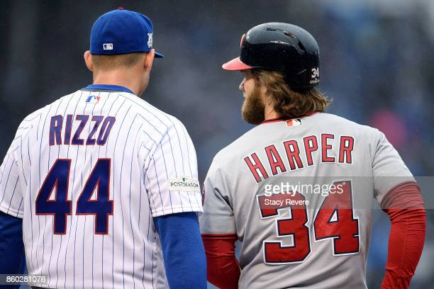 Anthony Rizzo of the Chicago Cubs and Bryce Harper of the Washington Nationals meet in the first inning during game four of the National League...