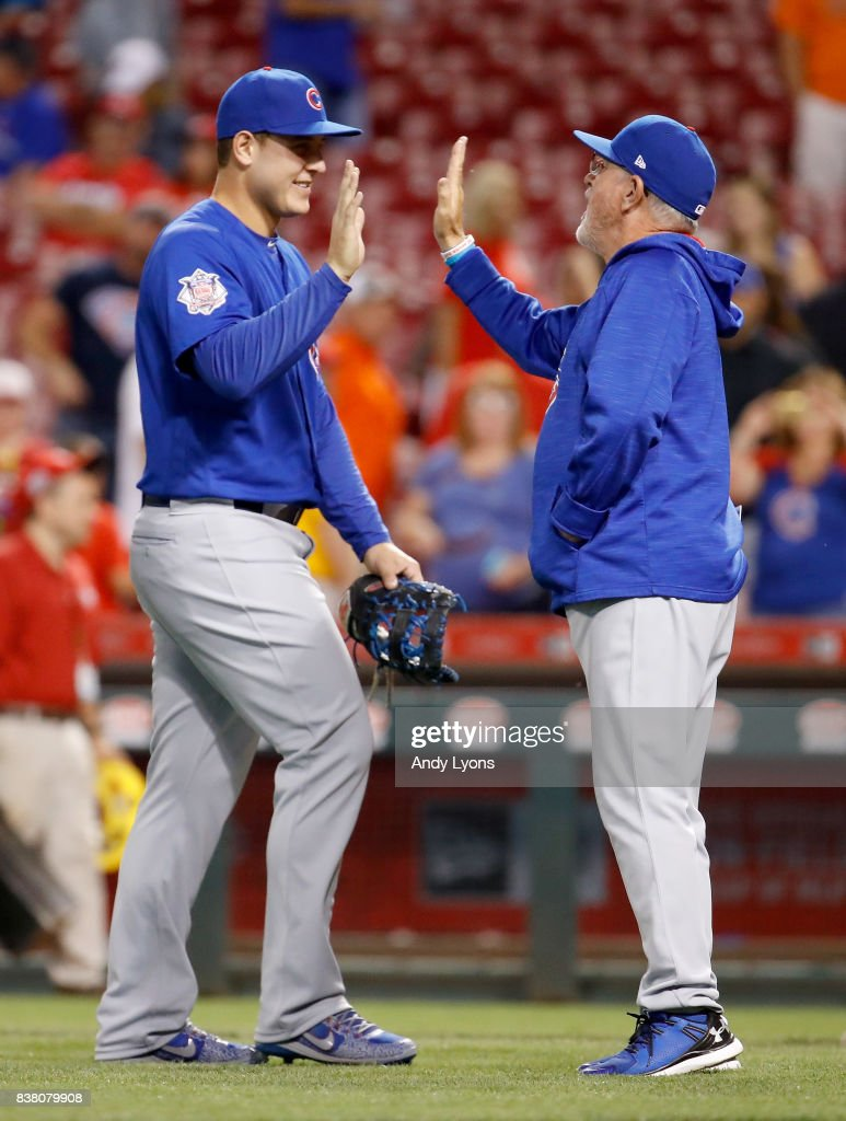 Anthony Rizzo #44 of the Chicago Cubs and Joe Maddon the manager celebrate after the 9-3 win against the Cincinnati Reds at Great American Ball Park on August 23, 2017 in Cincinnati, Ohio.
