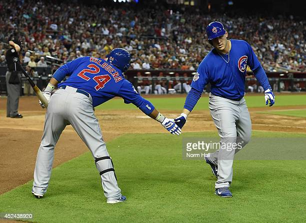 Anthony Rizzo of the Chicago Cubs celebrates a sixth inning home run with teammate Luis Valbuena against the Arizona Diamondbacks at Chase Field on...