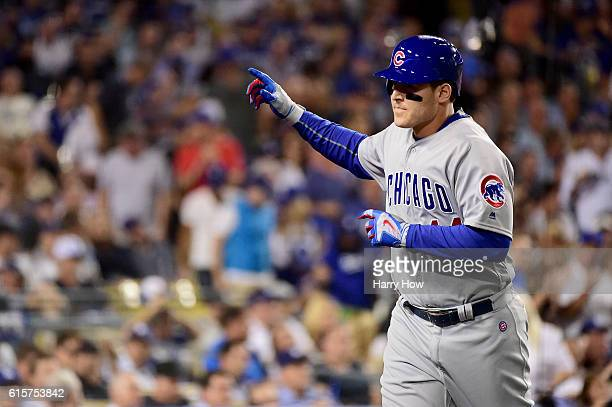 Anthony Rizzo of the Chicago Cubs celebrates after he hits a solo home run in the fifth inning against the Los Angeles Dodgers in game four of the...