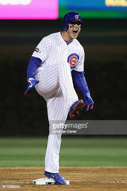 Anthony Rizzo of the Chicago Cubs celebrates after hitting a double in the first inning against the Los Angeles Dodgers during game six of the...