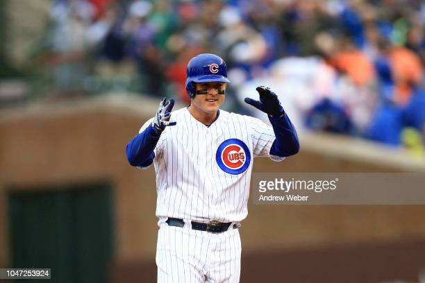 Anthony Rizzo of the Chicago Cubs celebrates after hitting a RBI double in the third inning against the St Louis Cardinals at Wrigley Field on...