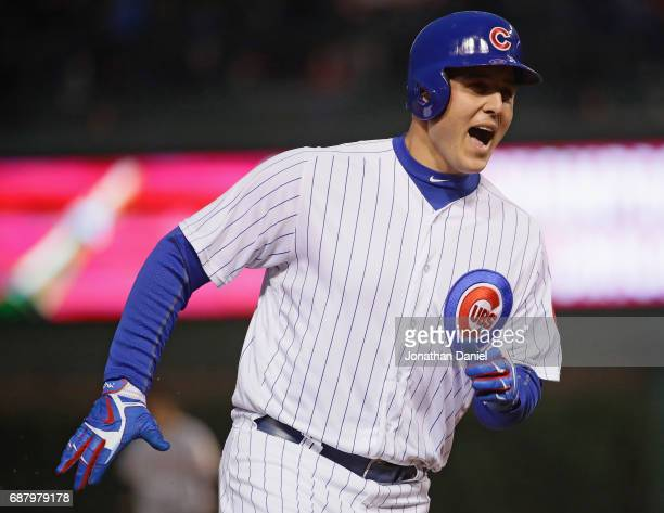 Anthony Rizzo of the Chicago Cubs celebrates as he runs the bases after hitting his second home run of the game a solo shot in the 4th inning against...