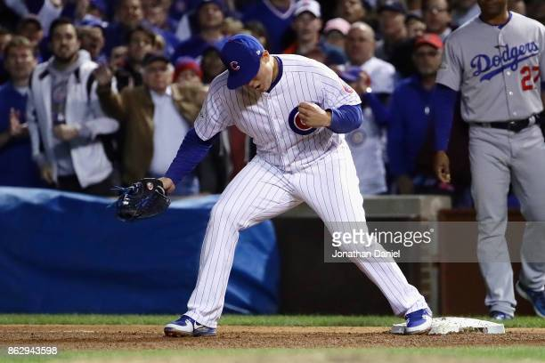 Anthony Rizzo of the Chicago Cubs celebrates defeating the Los Angeles Dodgers 32 in game four of the National League Championship Series at Wrigley...
