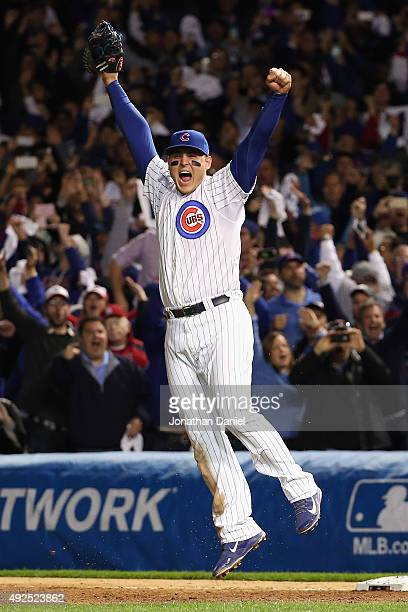 Anthony Rizzo of the Chicago Cubs celebrates defeating the St Louis Cardinals 64 in game four of the National League Division Series at Wrigley Field...