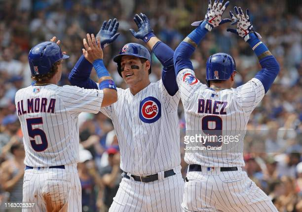 Anthony Rizzo of the Chicago Cubs celebrates his 3rd inning grand slam home run with Albert Almora Jr. #5 and Javier Baez against the San Diego...