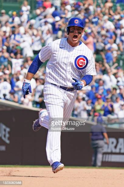 Anthony Rizzo of the Chicago Cubs celebrates his home run during the sixth inning of a game against the St. Louis Cardinals at Wrigley Field on June...