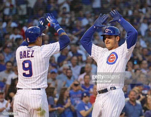 Anthony Rizzo of the Chicago Cubs celebrates his two run home run with Javier Baez in the 1st inning against the Cincinnati Reds at Wrigley Field on...