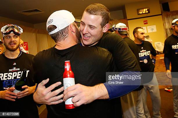 Anthony Rizzo of the Chicago Cubs celebrates in the locker room after defeating the San Francisco Giants 6-5 in Game Four of their National League...