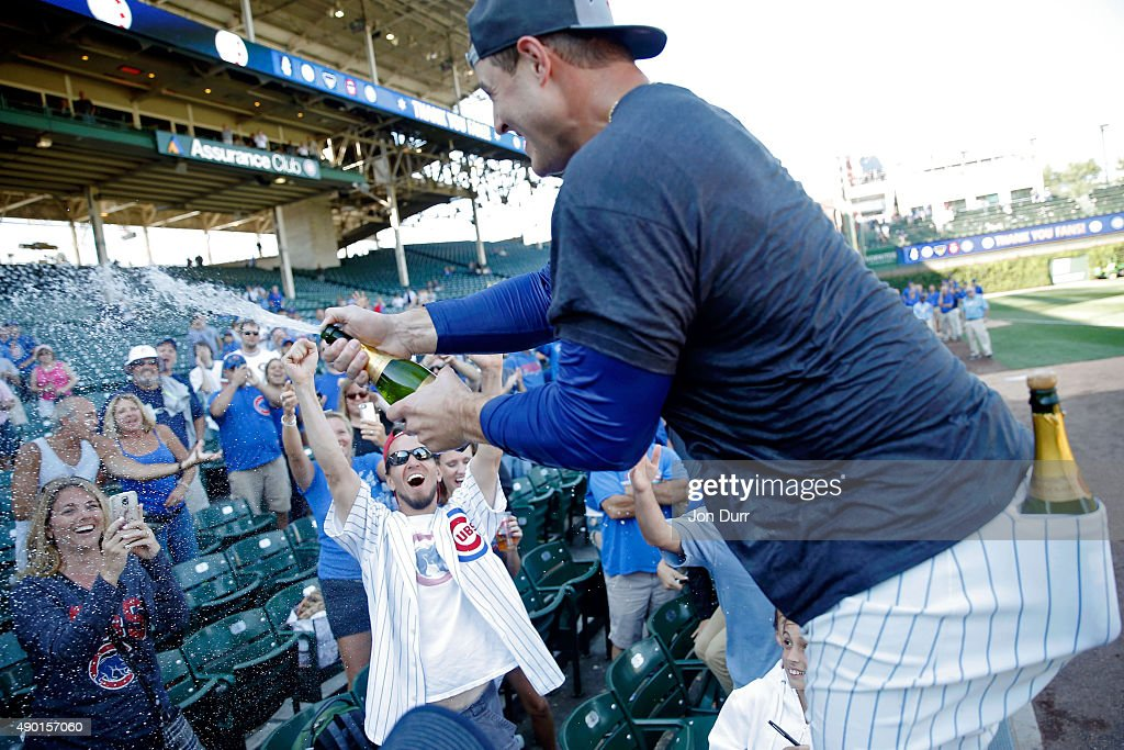 Anthony Rizzo #44 of the Chicago Cubs celebrates with fans after clinching their wildcard playoff position at Wrigley Field on September 26, 2015 in Chicago, Illinois.