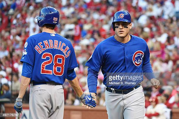 Anthony Rizzo of the Chicago Cubs celebrates with Kyle Hendricks of the Chicago Cubs after scoring a run in the third inning against the St Louis...