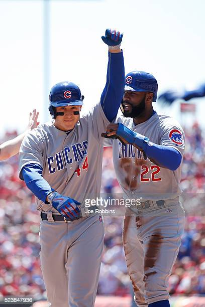 Anthony Rizzo of the Chicago Cubs celebrates with teammate Jason Heyward after hitting a tworun home run against the Cincinnati Reds in the first...