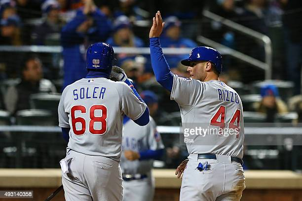 Anthony Rizzo of the Chicago Cubs celebrates with teammates Jorge Soler after scoring off of Starlin Castro's double to center field in the fifth...