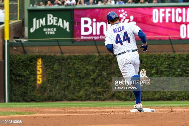 Anthony Rizzo of the Chicago Cubs circles the bases after hitting a solo home run during the fifth inning against the Milwaukee Brewers on Monday,...