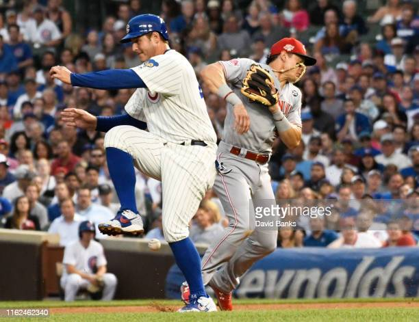 Anthony Rizzo of the Chicago Cubs collides with Derek Dietrich of the Cincinnati Reds during the fourth inning at Wrigley Field on July 16, 2019 in...