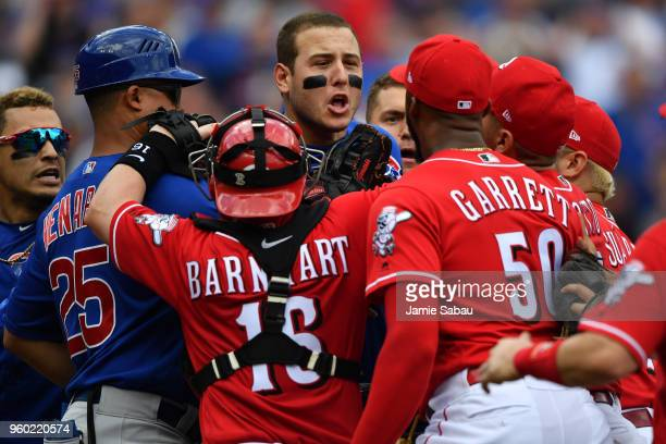 Anthony Rizzo of the Chicago Cubs confronts pitcher Amir Garrett of the Cincinnati Reds at the end of the seventh inning at Great American Ball Park...
