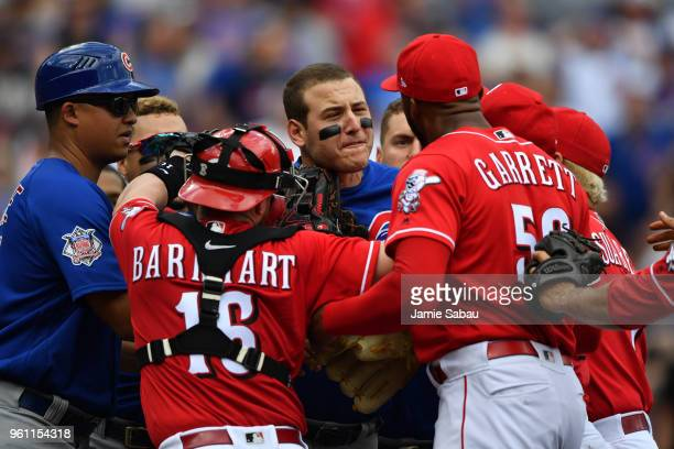 Anthony Rizzo of the Chicago Cubs confronts pitcher Amir Garrett of the Cincinnati Reds at Great American Ball Park on May 19 2018 in Cincinnati Ohio...