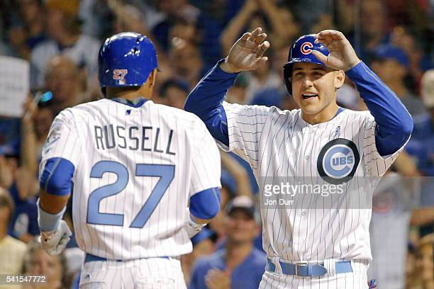 Anthony Rizzo of the Chicago Cubs congratulates Addison Russell on his two run home run against the Pittsburgh Pirates during the seventh inning at...
