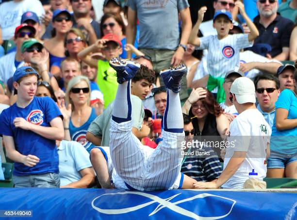 Anthony Rizzo of the Chicago Cubs dives in the stands for a foul ball hit by Brandon Guyer of the Tampa Bay Rays during the seventh inning on August...