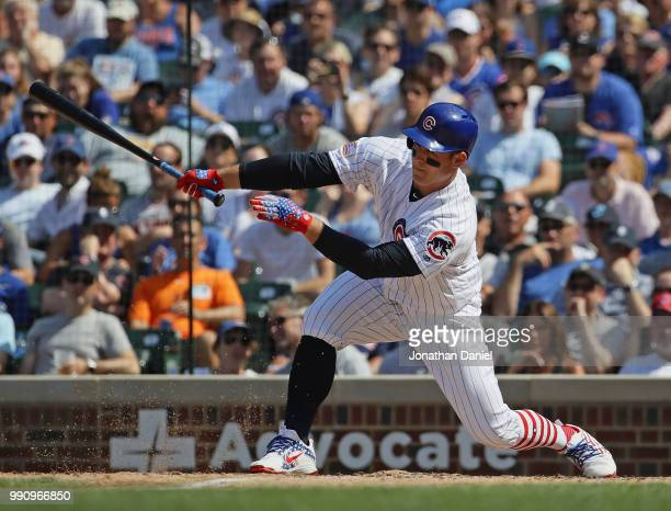 Anthony Rizzo of the Chicago Cubs drives in a run in the 7th inning against the Detroit Tigers at Wrigley Field on July 3 2018 in Chicago Illinois