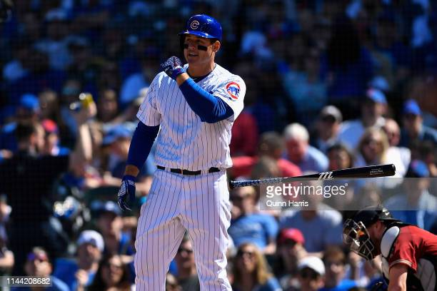 Anthony Rizzo of the Chicago Cubs flips his bat after being hit by pitch in the sixth inning against the Arizona Diamondbacks at Wrigley Field on...