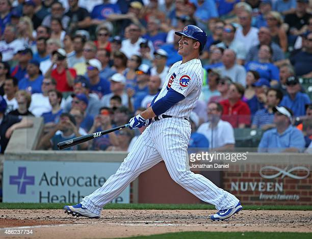 Anthony Rizzo of the Chicago Cubs follows the flight of his solo home run in the 4th inning against the Cincinnati Reds at Wrigley Field on September...
