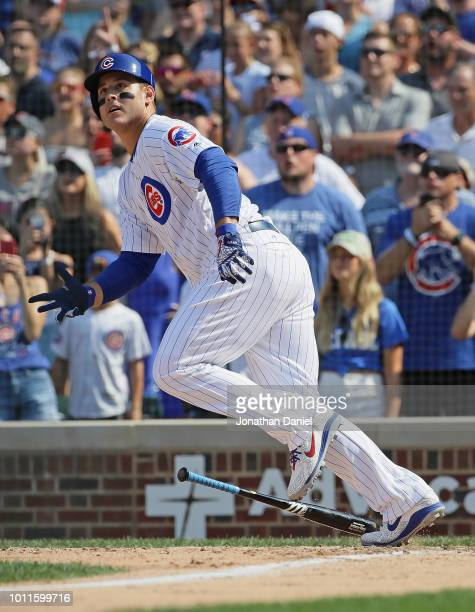 Anthony Rizzo of the Chicago Cubs gets a pinch hit run scoring single in the 7th inning against the San Diego Padres at Wrigley Field on August 5...