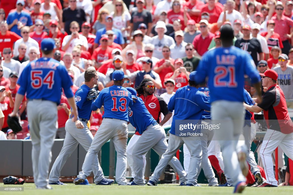 Anthony Rizzo #44 of the Chicago Cubs gets in the middle of a scuffle following the top of the tenth inning in the game against the Cincinnati Reds at Great American Ball Park on July 10, 2014 in Cincinnati, Ohio. The Cubs won 6-4 in 12 innings.