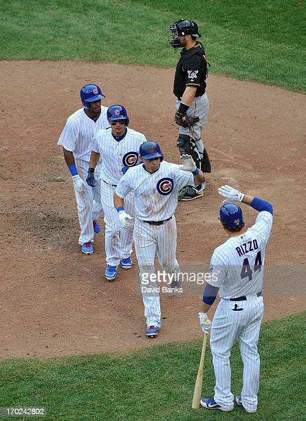 Anthony Rizzo of the Chicago Cubs greets Cody Ransom after Ranom's three run homer against the Pittsburgh Pirates during the seventh inning on June 9...