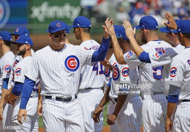 Anthony Rizzo of the Chicago Cubs greets teammates during player introductions before the home opening game between the Cubs and the Pittsburgh...