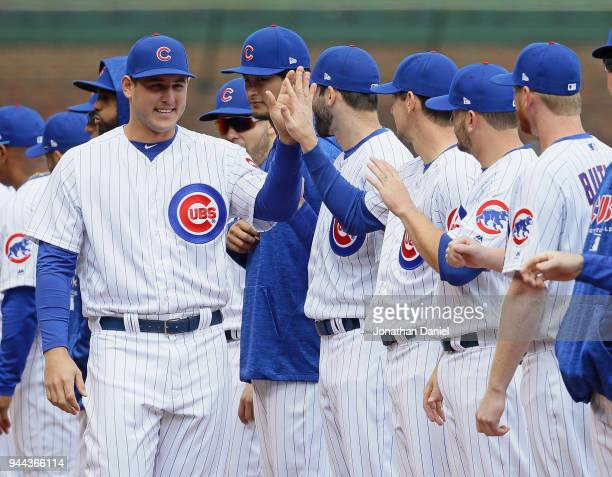 Anthony Rizzo of the Chicago Cubs greets teammates during player rintroductions before the Opening Day home game against the Pittsburgh Pirates at...