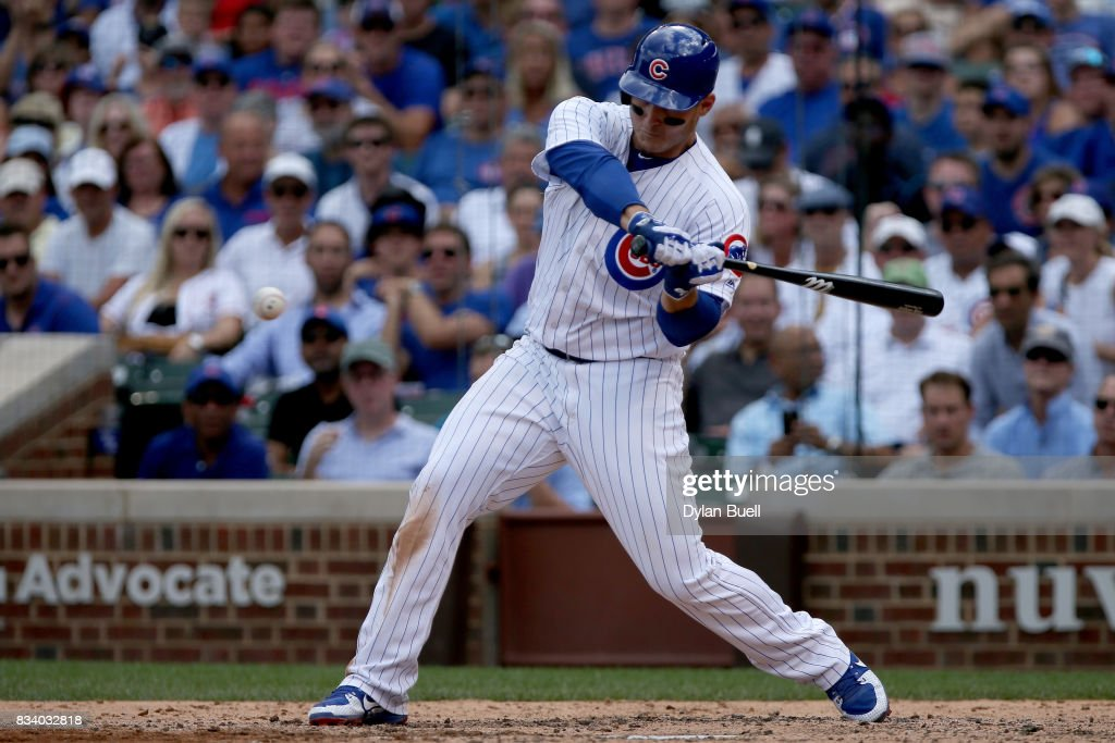 Anthony Rizzo #44 of the Chicago Cubs hits a double in the fifth inning against the Cincinnati Reds at Wrigley Field on August 17, 2017 in Chicago, Illinois.