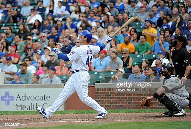 Anthony Rizzo of the Chicago Cubs hits a grand slam home run against the Pittsburgh Pirates in the sixth inning on September 16 2012 at Wrigley Field...