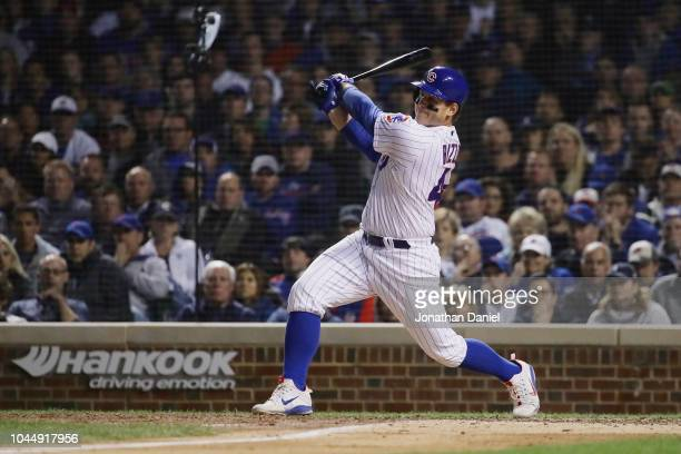 Anthony Rizzo of the Chicago Cubs hits a single in the eighth inning against the Colorado Rockies during the National League Wild Card Game at...