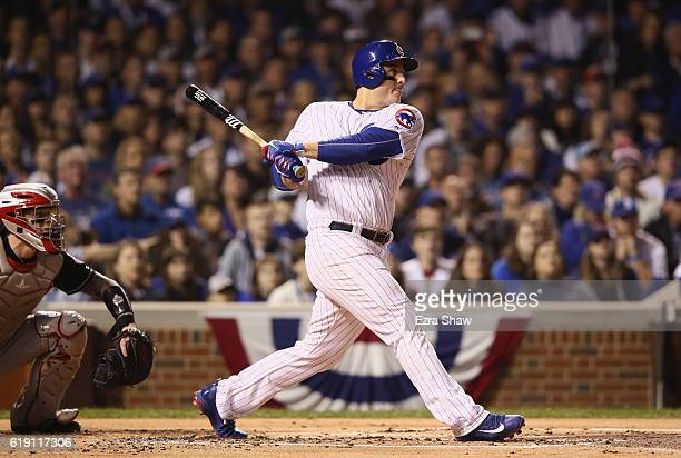 Anthony Rizzo of the Chicago Cubs hits a single in the first inning against the Cleveland Indians in Game Four of the 2016 World Series at Wrigley...