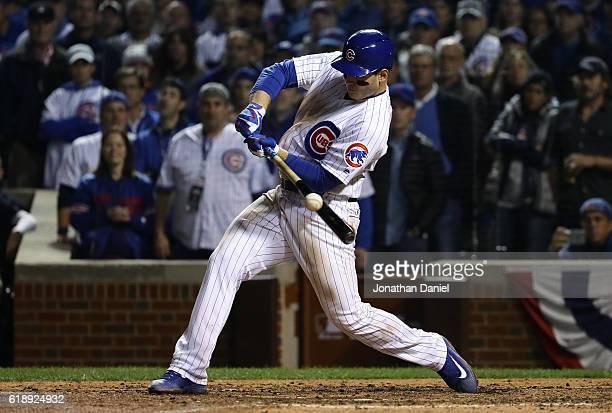 Anthony Rizzo of the Chicago Cubs hits a single in the ninth inning against the Cleveland Indians in Game Three of the 2016 World Series at Wrigley...