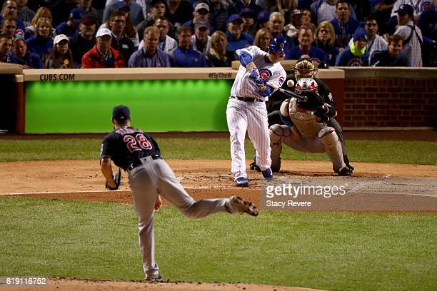 Anthony Rizzo of the Chicago Cubs hits a single off of Corey Kluber of the Cleveland Indians in the first inning in Game Four of the 2016 World...